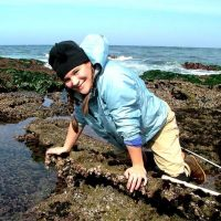 Donna helping with Glenn VanBlaricom's long term black abalone census project on San Nicholas Island in 2004