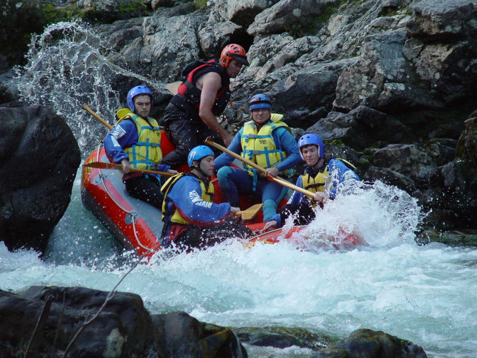 Allan Hicks with Trevor Branch (bottom right, PhD, 2004) and Arni Magnusson (top left, MS, 2002; PhD, 2016) calmly navigating the rapids in New Zealand, as they do with stock assessment.