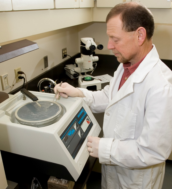 Craig preparing an otolith for radiocarbon analysis