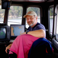 At the helm of the R/V Centennial