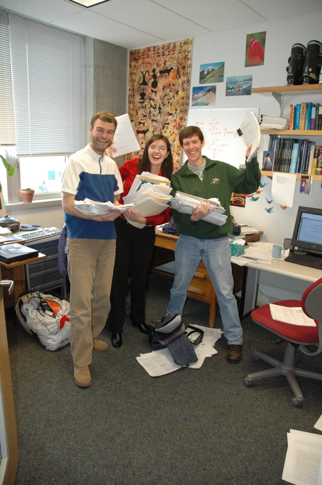 With my Lab mates, Arni Magnusson (MS, 2002; PhD, 2016) and Trevor Branch (PhD, 2004), on the day of my defense (November 5th 2004) holding many draft copies of my dissertation, ready for recycling.