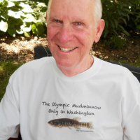John W. Meldrim in 2014, featuring Novumbra T-shirt sold at first Olympic Mudminoow Symposium (2012), in which he was the lead speaker.