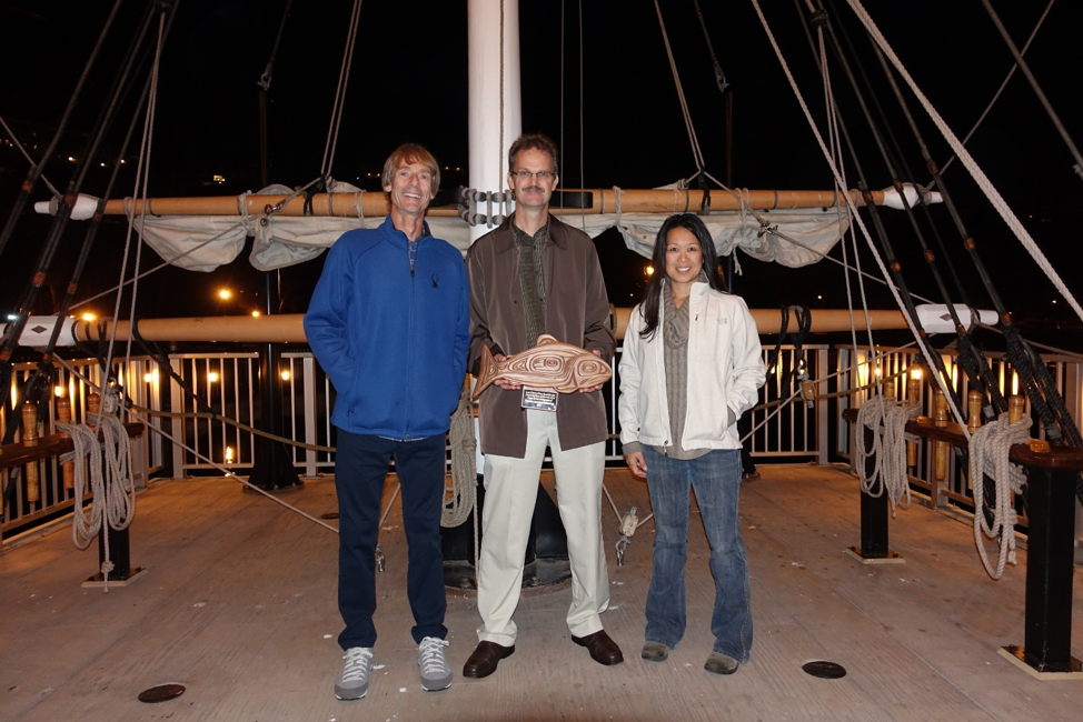Paul Crone and Mark Maunder (CAPAM cofounders with UW (Zoology) alumni Brice Semmens) receiving the American Institute of Research Fishery Biology (AIFRB) Outstanding Group Award on behalf of CAPAM from Kim Anthony, president of AIRFB.