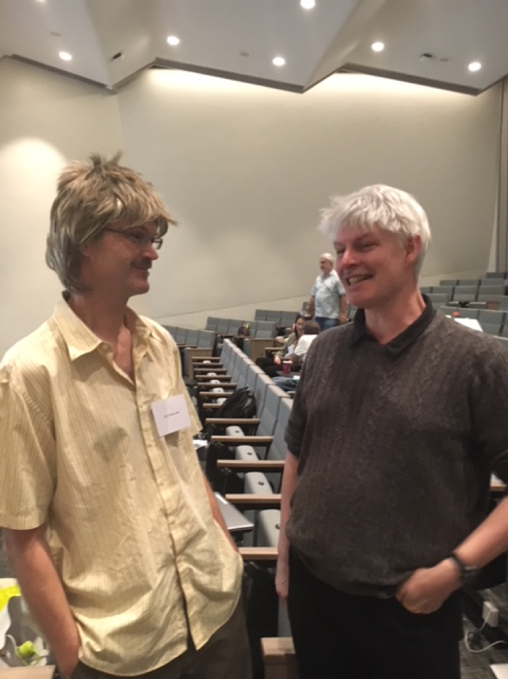 Mark Maunder dressed as the 1990s version of André Punt (UW postdoc at that time) during Halloween at the 2017 CAPAM workshop on recruitment, standing beside the modern-day UW School of Fisheries and Aquatic Sciences Director and Professor version.