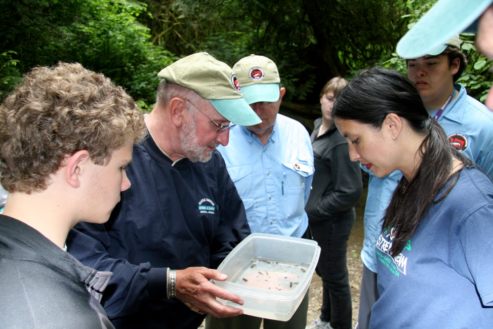 Jim Karr and students at the Northwest Youth Conservation and Fly Fishing Academy, 2008, examining bugs from MacLean Creek in Capitol State Forest.