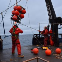 Researchers lowering the Chukchi Ecosystem Observatory (CEO) innto the Chukchi Sea. University of Alaska Fairbanks