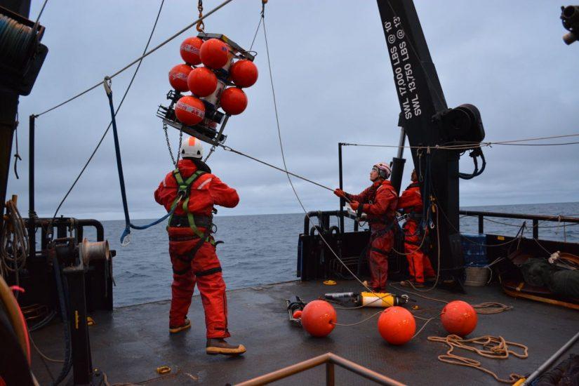 Researchers lowering the Chukchi Ecosystem Observatory (CEO) innto the Chukchi Sea. University of Alaska Fairbanks