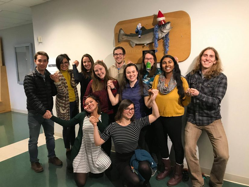 SAFS 2016 Cohort at the Holiday Party. Mounted fish on wall in background wearing a party hat