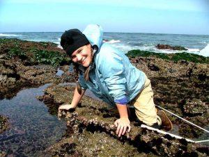 Donna helping with Glenn VanBlaricom's long term black abalone census project on San Nicholas Island in 2004