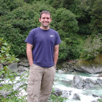 Eric standing on the bank of a river near Franz Josef Glacier