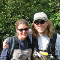 Sue Johnson and Jon Moore during a sockeye salmon spawner survey on Ice Creek, Lake Nerka, Alaska