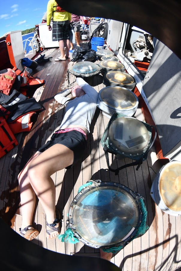 Kerry-Anne Rogers (Muhlenberg College) is exhausted on the deck after a FAD (Fish Aggregating Device) recovery mission on Nikumaroro.