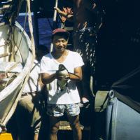 Bell Shimada holding a penguin, circa 1957.