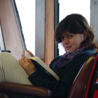 Ivonne reading while on a tagging research cruise to the Aluetians in 2003