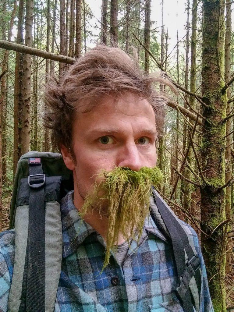 Berdahl with moss on his face, imitating a beard